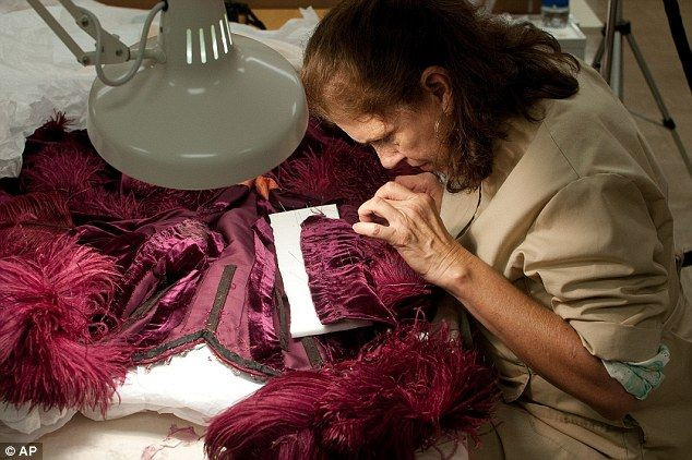 Refurbishing the burgundy ballgown from Gone With the Wind