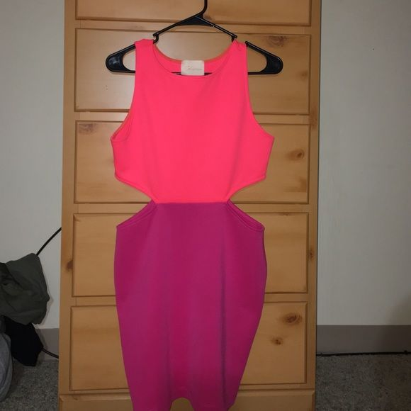 Cut Out, Color Block Dress Sexy birthday dress! Hot fuchsia and highlighter orange dress. Sides are cut out! Only worn once! Perfect condition! Dresses Mini
