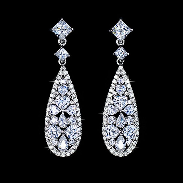 This beautiful vintage style dangle earrings is individually handcrafted with sparkling multi-shaped cubic zirconia diamond. We use top grade AAA swiss-made CZ, the earrings is eco-friendly and does not contain lead, nickel or cadmium. It features high quality white gold rhodium plated for tarnish resistance and a long lasting mirror finish.
