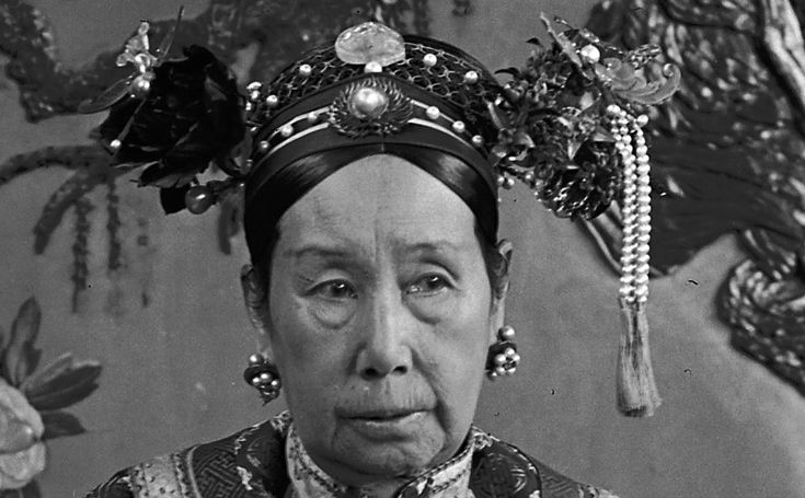 Empress Dowager Cixi's headdress encrusted with pearls and stones.