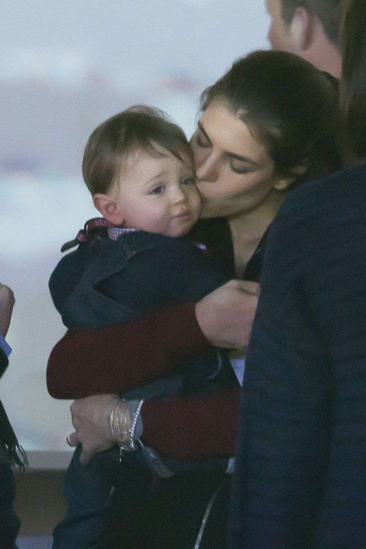 Charlotte Casiraghi and her baby son Raphäel cuddle at the Gucci Masters in Paris at the beginning of December.