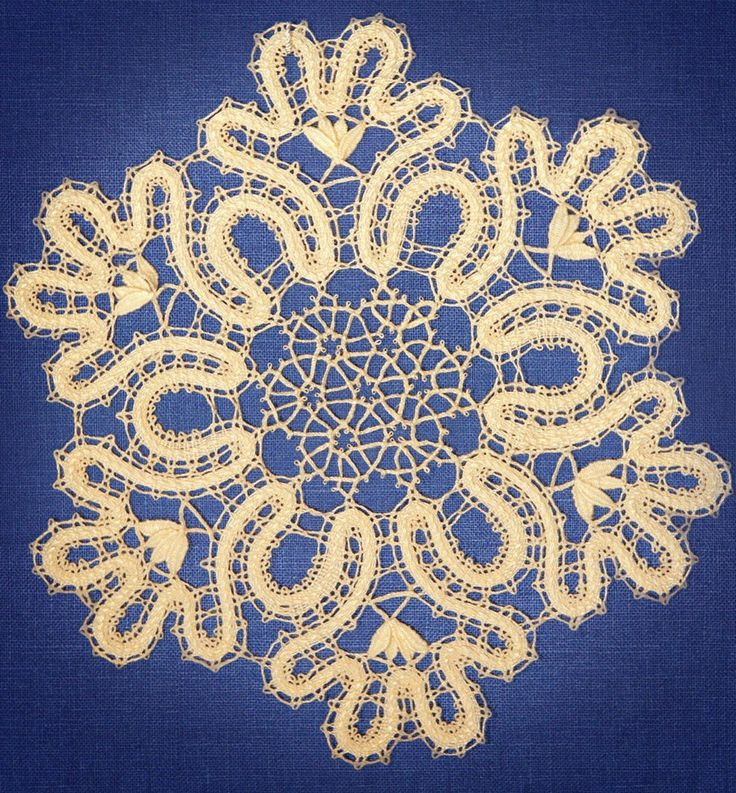 Bobbin lace from the Russian town of Vologda. Stylized snowflake. #Russian #lace