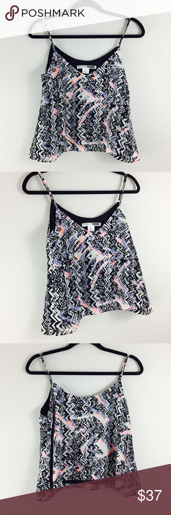 """Necessary Objects Printed Halter Cami Necessary Objects Printed Halter Cami   Details:  A loose fit sleeveless top is styled with allover print. * Wide {Pit to Pit}: 16""""  * Long: 20""""  * Colors: Black, White, Coral & Purple  *  V-neck * Sleeveless * V-back *  Lined * Size: Small * Retail Price: $72 * NWOT  * Made in USA  Fiber Content * 100% Polyester  Care * Dry clean or hand wash cold  🏷 Matching shorts also listed in my closet.   📌Measurements are approximate  ✂️ 15% Discount on 2 of…"""