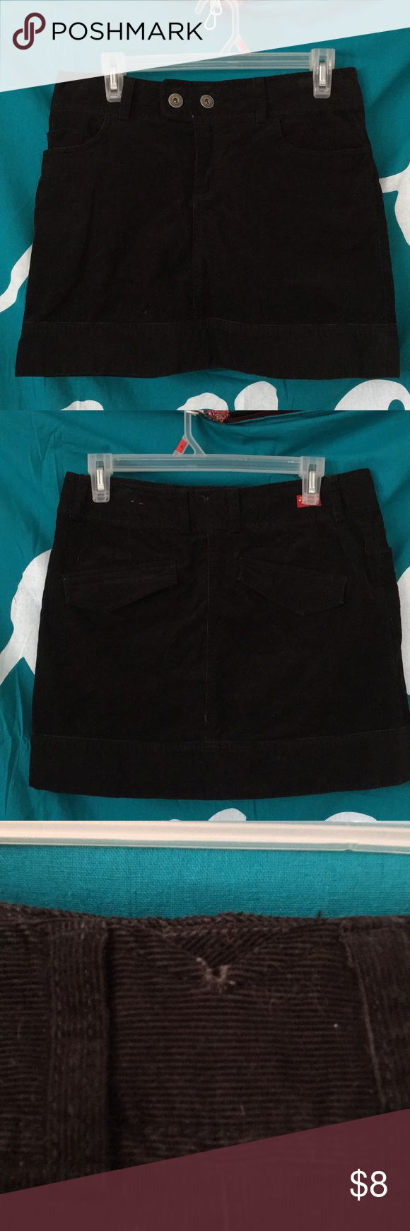 Eastern Mountain Sports Black corduroy miniskirt Adorable black corduroy mini skirt from Eastern Mountain sports. Two buttons in the front, a notch VE at the back with slight signs of wear. Pic shows the area in detail. Generous sizing, fits slightly larger than the standard 4 in women's. eastern mountain sports Skirts Mini