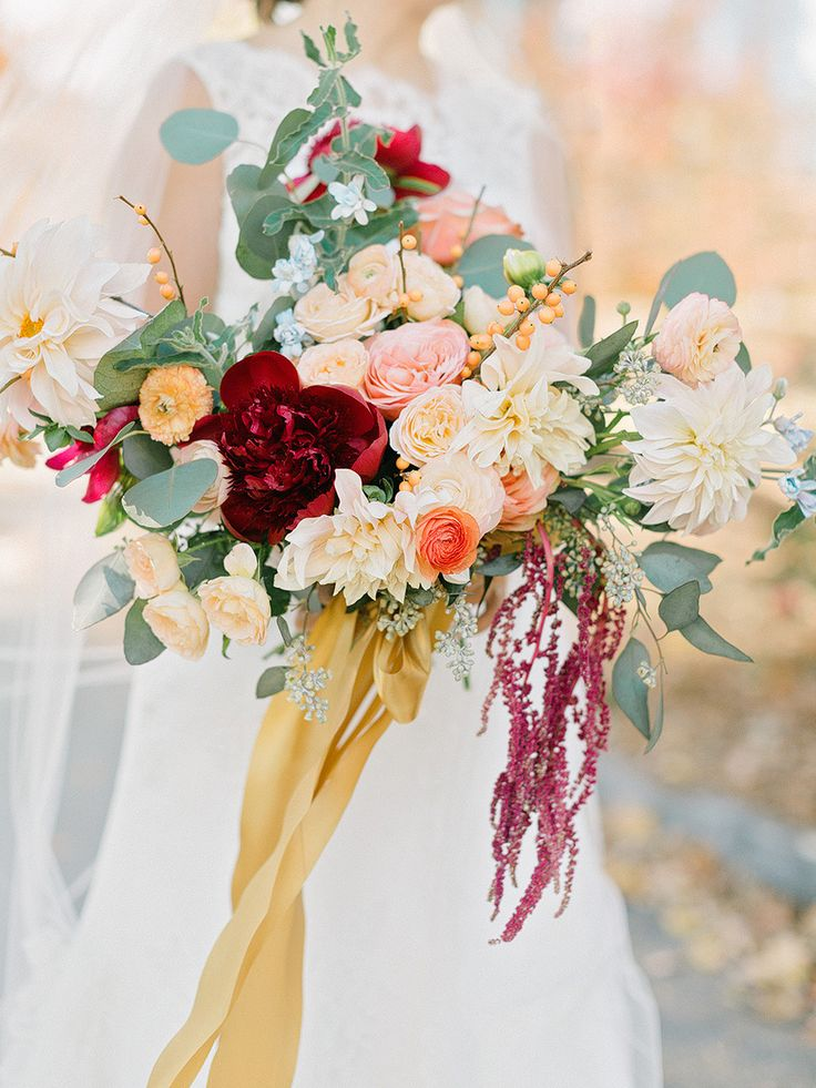 colorful large bouquet with mustard ribbons | Photography: Elizabeth Marie Weddings + Events