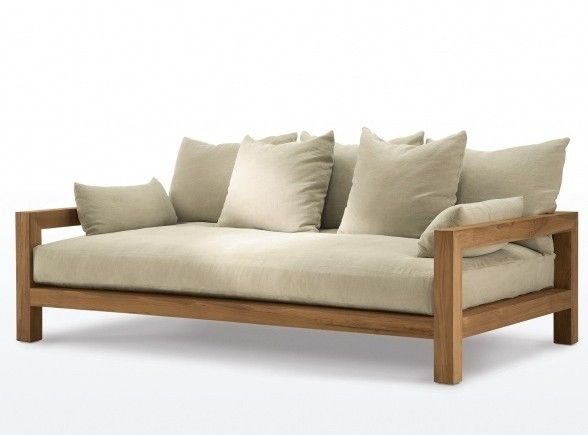 A teak Montecito Daybed from James Perse Furniture has weather resistant cushions and is manufactured in the US. For more information and pricing, see James Perse.