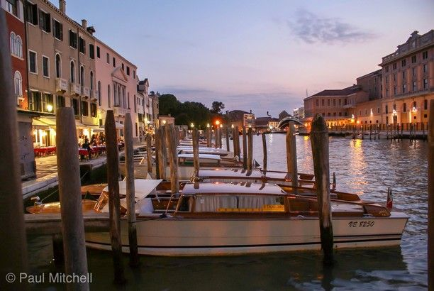 venezia, Venice, Italy — by Paul Mitchell. It was dusk in Venice the sky was a lovely colour and the lights shining on the water looked great, I so wish I was...