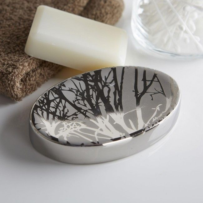 Freshen up your bathroom decor with these attractive Moda At Home Tree countertop accessories. Great for organizing all of your bathroom items.