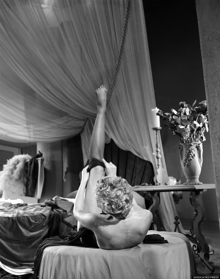 "Burlesque artist Lili St. Cyr pulls on stockings during a rehearsal of her interpretive dance for the three-dimensional short film ""Carmenesque"" on January 23, 1953 in Los Angeles. (AP Photo/Ellis R. Bosworth)"