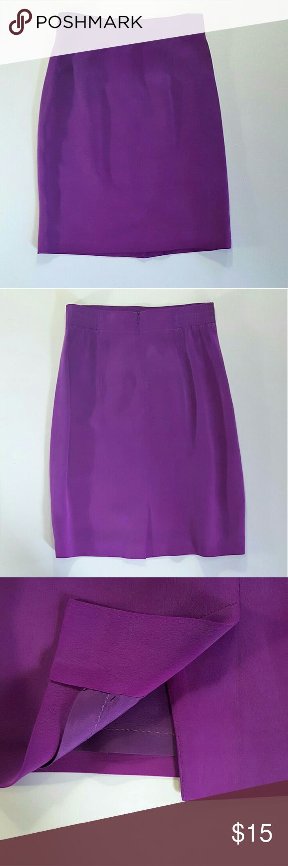 """Dana Buchman 100% Silk Skirt Very good overall condition with few signs of wear. Some minor fading if any.  22"""" length, 13 1/2"""" across waist. Elastic at back of waist, short slit on back. Very lively shade of purple (keep in mind that I tried to get the exact shade/ correct color but actual colors vary according to light and screens). Dana Buchman Skirts Midi"""