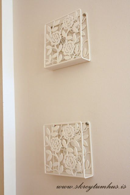 IKEA napkin holders hung on a wall, could maybe hold magazines in the bathroom or be a place to leave the mail