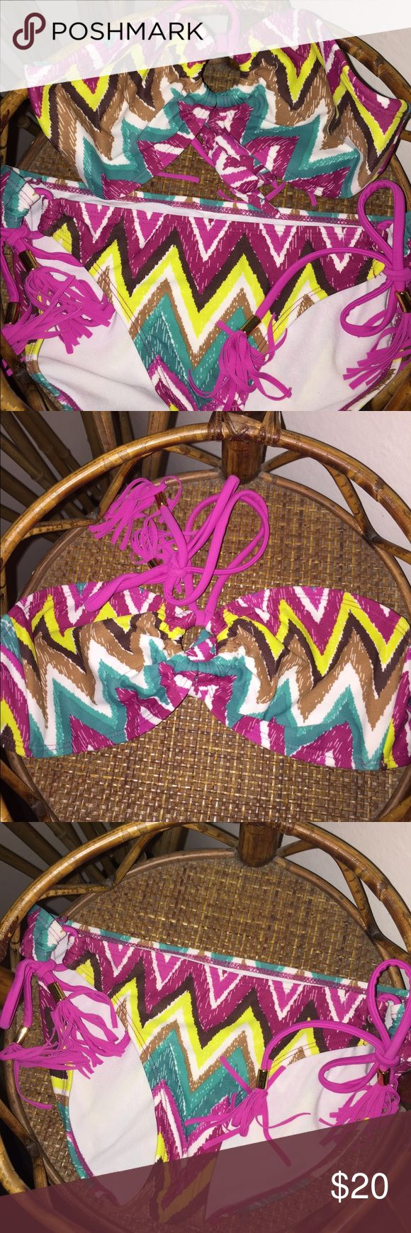 ⬇️PRICE DROP⬇️Aztec Bikini This 2-Piece Bikini comes BRAND NEW without tags. Super cute pink and green Aztec design. Bandeau top with neck ties and medium rise bottoms with side ties. This is a size small and would fit up to a B cup comfortably. Really cute!!! My prices fluctuate from time to time. Catch them when prices are low!❤️ Swim Bikinis