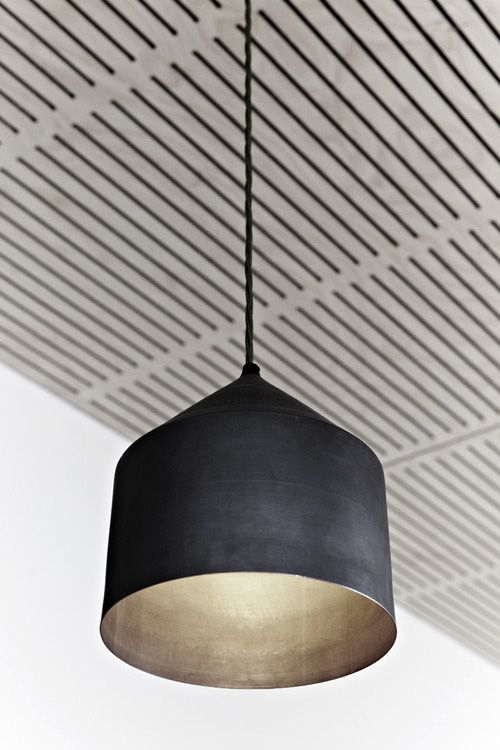Great matte black pendant w/ metallic interior.  Not to mention a cool ceiling.