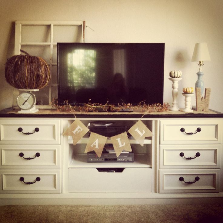 bedroom tv stand dresser. mini pumpkins on top of candle stick holdres  fall leaves garland below TV wicker pumpkin Best 25 Dresser tv stand ideas Pinterest to