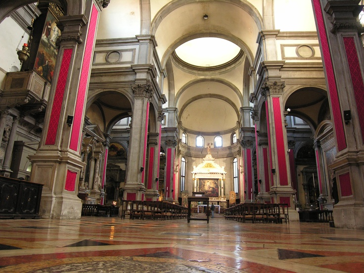 Interior Nave and Altar -- San Salvador, Venice, Italy - Restrained and severe the interior is high Renaissance. San Salvador has a nave, aisles and transepts. There are three cupolas. Vicenzo Scamozzi cut holes in them to add light in 1574.