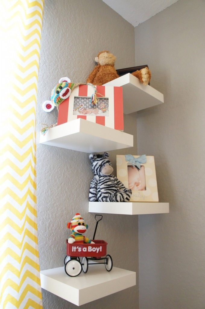 Painted red and blue and then topped with the nautical decor/ placed above the bookshelf.