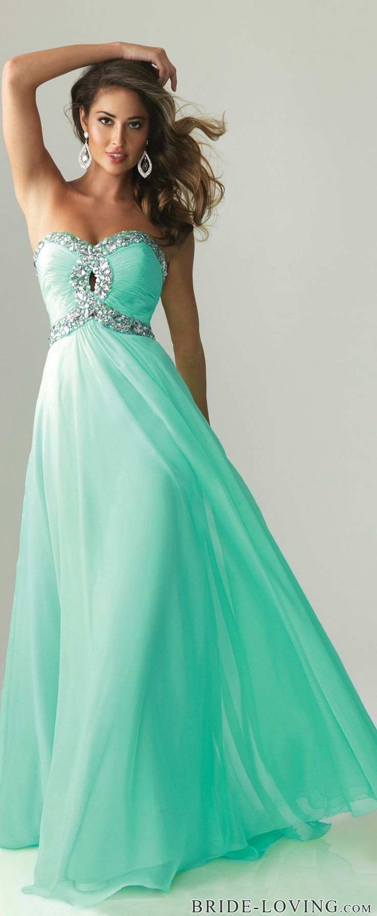 Mint formal gown loving the detail on the bust and the way it flows out very simple but eligant