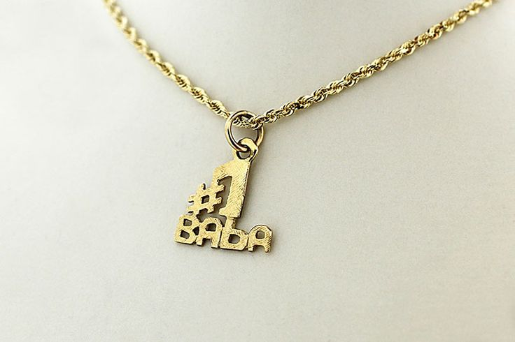 """14kt gold pendant featuring the words """"#1 Grandmother"""" in Ukrainian."""