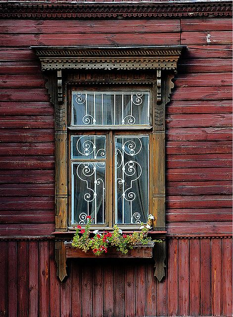 Beautiful window with stain-glass and wonderful trim work. Interesting siding too.