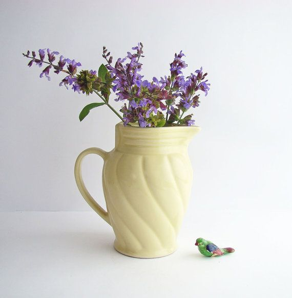 This was originally an old electric jug from the 1930s - 40s that has been converted to use as a vase or water/drinks jug. It is a lovely shade of