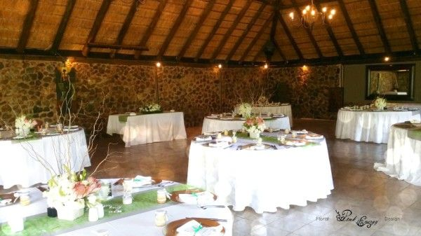 Reception - Flowers included Proteas, White Lisianthus, White Chinks and Willow Twines in keepsake square LOVE pots. River Place, Hennops River Valley, just outside Fourways, Johannesburg. Floral Design & Decor  by www.pinkenergyfloraldesign.co.za