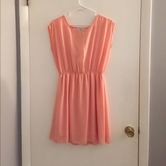 Peach coral sundress Pretty peach \ coral sundress, worn once for an event and haven't worn it since, too big for me. Dresses