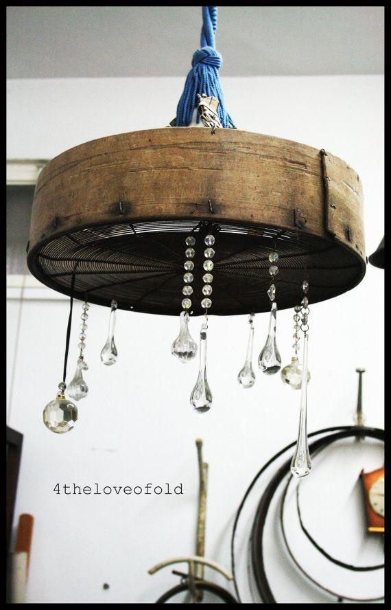Sieve chandelier with crystals.Lampadario setaccio con cristalli.