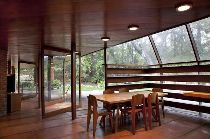 The dining area with glass walls that pivot open to up forest surroundings. --  The Schaffer Residence, located near Los Angeles at the foot of the Verdugo Mountains, was completed in 1949 and draws its design influence from the surrounding wooded area. Completed in 1949 it was recently restored. Photos by Elizabeth Daniels