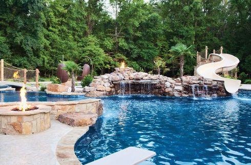 Elite Pools by Scott rock waterfall slide pool