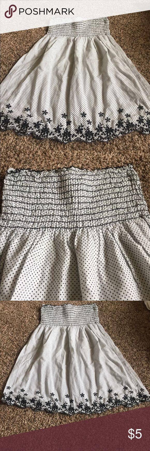 White with black polka dots smocked dress Beautiful little dress no straps, but you could add some ribbons. Smocked top and embroidered flowers on the bottom along the front and back listing it as Large but I would say this is a size 8 made in the USA cantata Dresses Casual