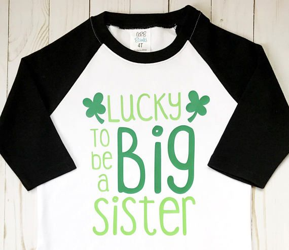 This childrens Lucky to Be a Big Sister shirt is the perfect top for a new sister to be. This St. Patricks Day t-shirt features a funny quote and shamrock designs. This top makes a unique gift for a toddler with a new baby sibling! Your little one can even wear this shirt for a creative