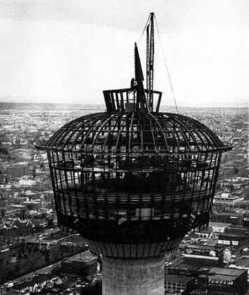 Photo of Calgary Tower being built. This is the open frame at the top.
