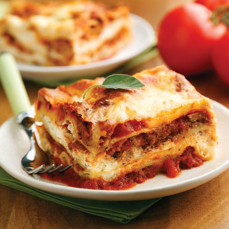 Our homemade Lasagna with Meat Sauce is a symphony of flavors and textures. We built layer after layer of tender noodles, robust meat sauce, and creamy, tangy ricotta cheese for a lasagna that will knock your socks off. By using ground turkey, we've been able to lighten up the lasagna (up to 100 calories less