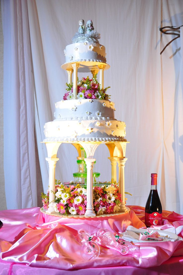 wedding cakes with pillars and flowers 3 tiered cake with flowers and pillars wedding cakes 26078