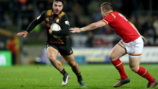 Chiefs wing James Lowe is tackled by Scott Williams of Wales.