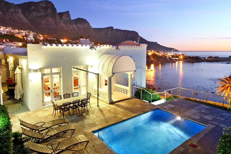 Large Luxury Self Catering Villa Accommodation in Camps Bay | A road separates the luxury self catering villa and the sea. This luxury self-catering boutique accommodation has or a 3 Bedroom Villa or a 2 bedroom Garden Apartment