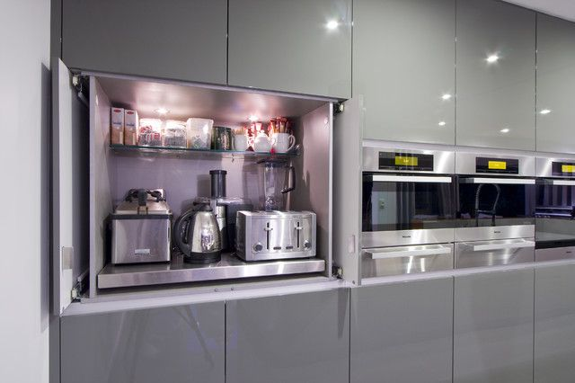 Pic #1:  The Best Places to Stash Small Kitchen Appliances  Tucked-away places like nooks, pantries and dedicated cabinets keep your kitchen gadgets handy but out of the way