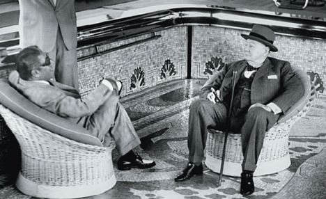Ari and Sir Winston Churchill sitting in the pool on the Christina O