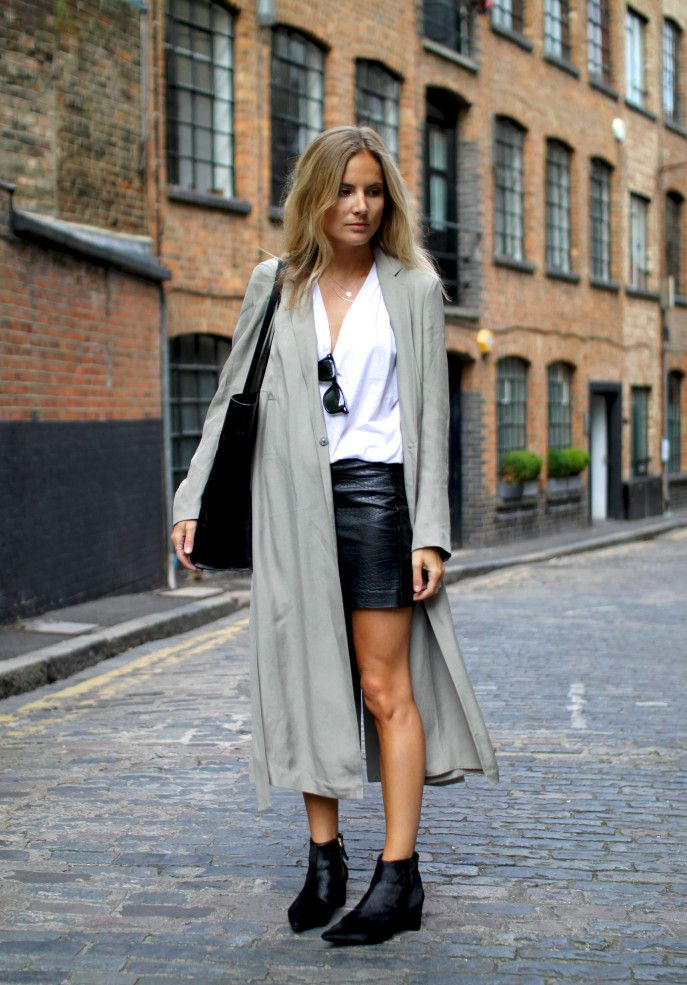 Long gray overcoat with black leather skirt and white shirt