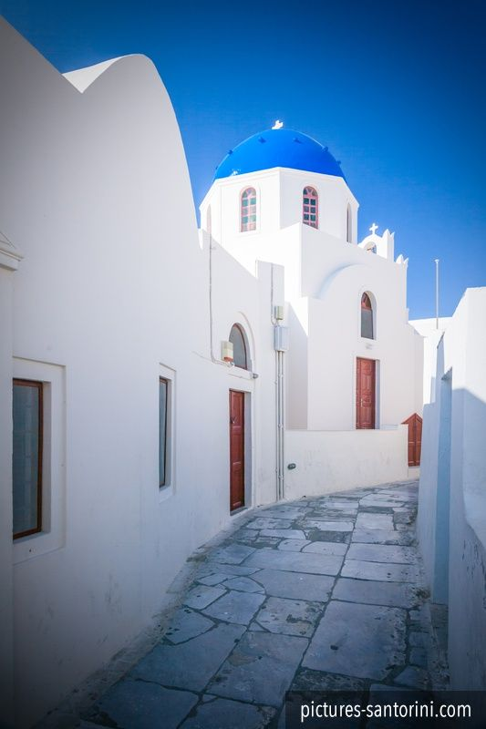 One of the many churches in white and blue against the deep blue sky.