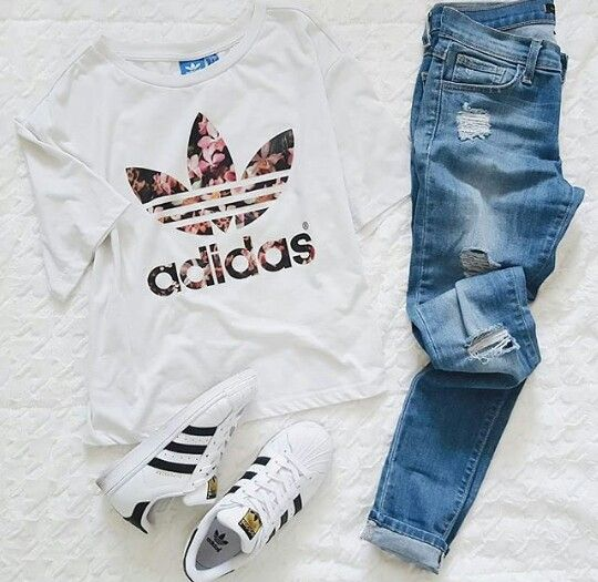 White tee with floral Adidas print, skinny jeans, and black and white Adidas