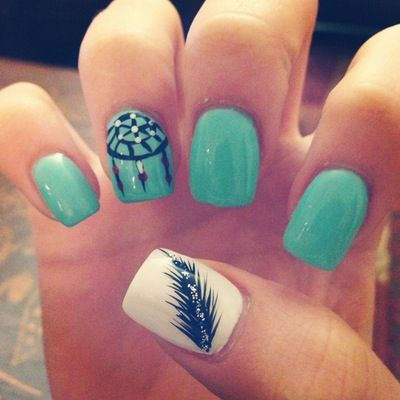 Blue and white nails with a feather and a dream catcher on it