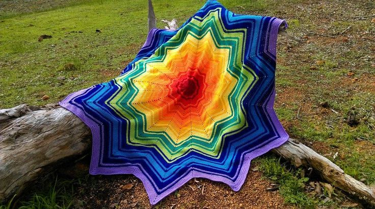 Round Rainbow Ripple - Crimson Beginnings. Project information and pattern link here; http://www.ravelry.com/projects/LindaDavie/rainbow-ripple-baby-blanket-2