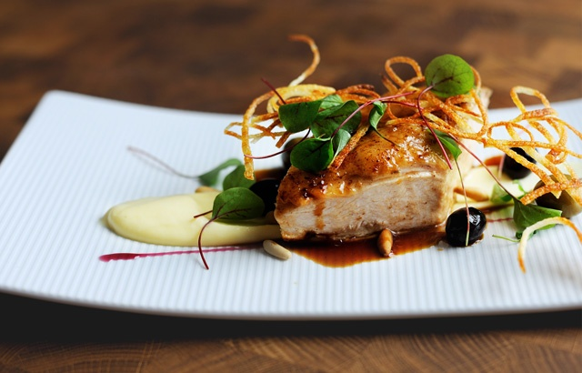 juicy chicken is accompanied by creamy potatoes and pine nuts to create a warming, succulent dish
