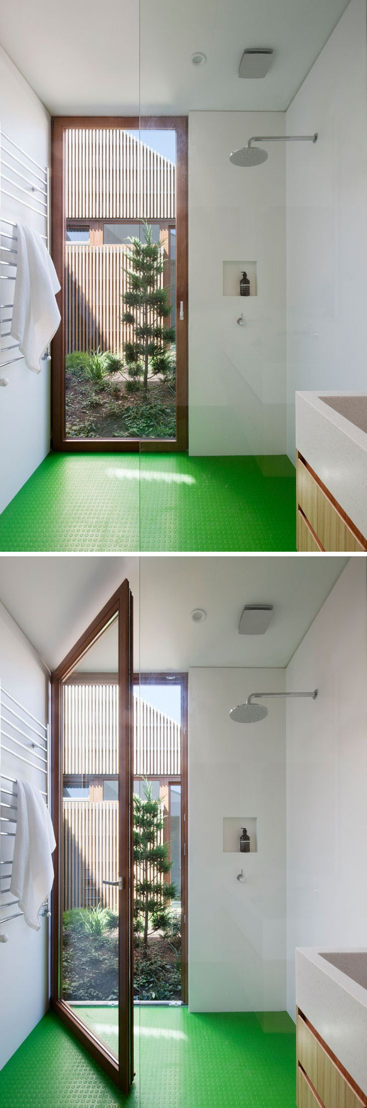 In this modern bathroom, there's bright green flooring and built-in shelving in the shower, and a floor-to-ceiling wood framed door that opens off the shower into the courtyard just outside.