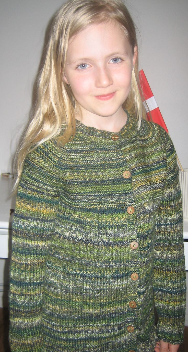 Different green colors sweater .