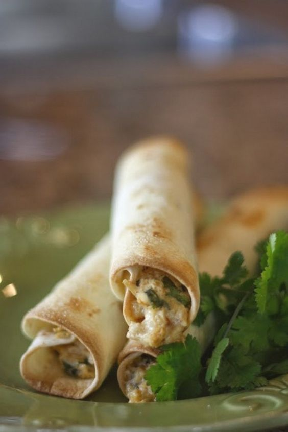 Easy and Delicious Homemade Crispy Chicken Taquitos with cream cheese, cilantro and pepper-jack cheese. Best chicken taquitos recipe pinterest has!