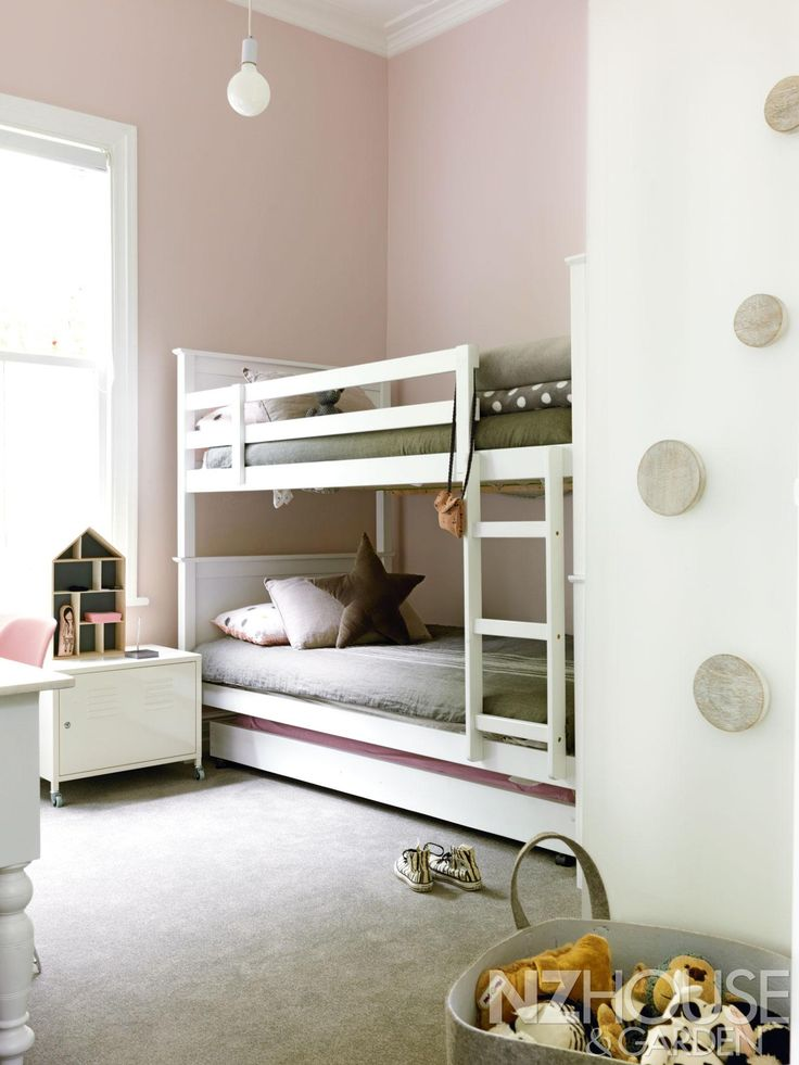 """Greer mixed the dusky shade of pink for Riley's bedroom walls from a mixture of Resene paints: """"Riley and I call it marshmallow""""; the round Muuto Dot coat hooks are from US store CB2 and are hand-finished in lime wax. - See more at: http://nzhouseandgarden.co.nz/the-art-of-renovating/#sthash.5Pqsq3W4.dpuf"""