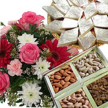 Perfect and traditional gift which is suitable for every Indian festival. This gift hamper includes : Bunch of 12 Mix Seasonal Flowers along with Assorted Dry Fruits Box (Net Weight : 500 Gms) and Kaju Katli Sweet Box (Net Weight : 500 Gms).  http://www.ghasitaramgifts.com/product/multi-color-flowers-with-dryfruits-kaju-katli/