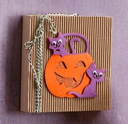 get into the halloween mood with this simple yet spooky cat in a pumpkin decoration